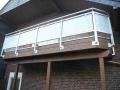 Vorgehängte Balkonanlage in Leimbinderkonstruktion