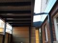 Carport mit Lichtband zum Haus als Flachdachkonstruktion