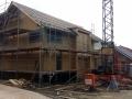 Einfamilienhaus in Holzrahmenbauweise/Beginn der Dacheindeckung