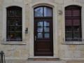 Holzhaustür mit eingelegter Kasettenfüllung und festverglastem Oberlicht