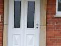 Meranti Haustür mit Kasettenfüllung und zwei Lichtausschnitten