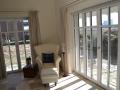 Meranti Holzfenster mit aufgesetzter Wiener Sprosse