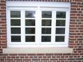 profiliertes Holzfenster mit Wiener Sprosse und Schlagleiste mit Kapitel