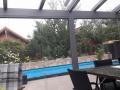 Aluminium Terrassendach mit Glas-Schiebetüren als Unterbauelement