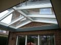 Exklusive Terrassenüberdachung Flachdachfries mit Lichtkuppel sowie integrierter Beleuchtung und Sonnenschutz