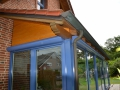 Holz-Aluminium Wintergarten mit geschlossener Dachziegelfläche