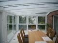 Innenraumfoto Wintergarten Holz/Aluminium. Unterbauelemente Kunststoff